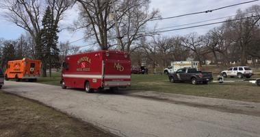 Officials are still searching for a woman after pulling a man's body from the DuPage River Monday morning near southwest suburban Shorewood.