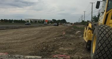 A long-delayed road project in the southwest suburbs is going to take even longer to finish, but the state saidit should be worth the wait.