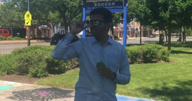 Mather High School Senior English Teacher Aneesh Shukla receives Enchroma glasses from his students