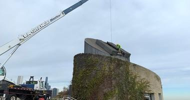 Wednesday marked a big day at the Alder Planetarium as a crane hoisted its giant telescope from its long-time home.