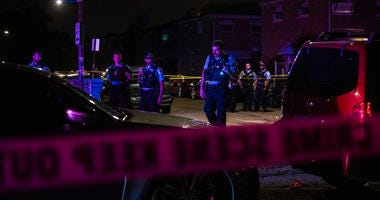 Chicago Police investigate the scene where multiple people were shot, Aug. 4, 2019, in the 4200 block of West 18th Street, in the Lawndale neighborhood.