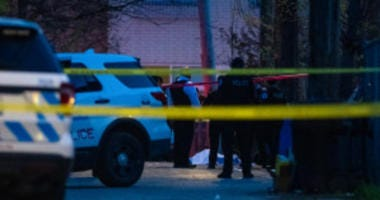Chicago Police investigate the scene where a man was shot and killed, Sunday morning, in the 1200 block of South Komensky, in the Lawndale neighborhood.