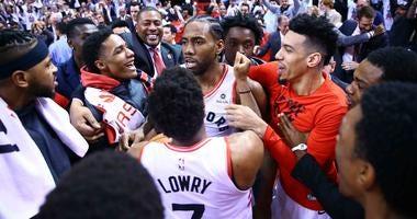 Kawhi Leonard and the Toronto Raptors celebrate his game-winning shot in Game 7 against the Philadelphia 76ers.