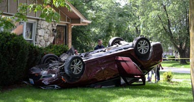 A car crashed into a house and flipped over while driving away from gunfire Aug. 22, 2019, near Lincoln and Cottage Grove avenues in Dolton.