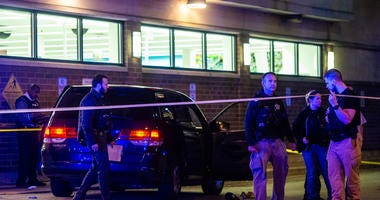 Chicago police investigate the scene where multiple people were shot, Thursday night, in the 3200 block of North Broadway, in the Lake View neighborhood. The shooting took place in the 2500 block of North Lake Shore Drive.