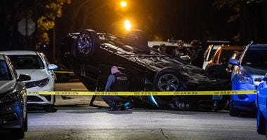 Chicago police investigate the scene where a 25-year-old man was shot and killed, Sunday night, in the 7900 block of South Luella Avenue, in the South Chicago neighborhood.