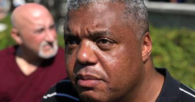 """Kennedy Expressway protest leader Rev. Gregory Livingston says it would be an honor to be arrested like the """"Mandelas, Kings, Gandhis and Jesus Christ."""""""