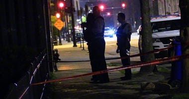 Chicago Police investigate the scene where 4 people were shot , Tuesday evening, in the 2200 block of West Maypole, in the West Town neighborhood.