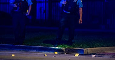 Chicago Police investigate the scene where a teen boy was shot, Thursday night, in the 4400 block of West Maypole, in the West Garfield Park neighborhood.