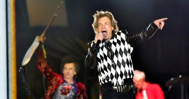 """Ron Wood, left, and Mick Jagger, of the Rolling Stones perform during the """"No Filter"""" tour at Soldier Field on Friday, June 21, 2019, in Chicago."""