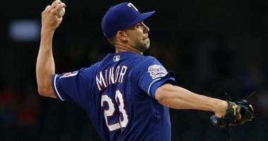 Mike Minor of the Texas Rangers delivers a pitch against the Los Angeles Angels.