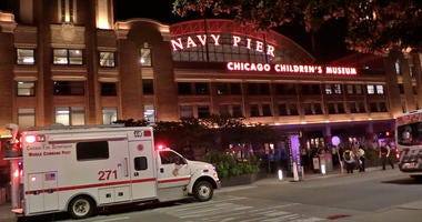 Crowds of people streamed out of Navy Pier, where a large police presence responded to reports of multiple people injured.