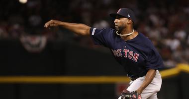 Boston Red Sox infielder Eduardo Nunez delivers a pitch during a blowout loss to the Arizona Diamondbacks.