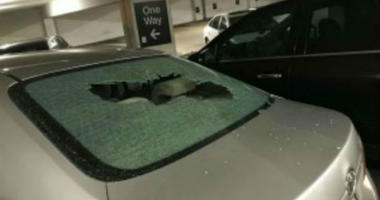 A vehicle with a broken rear windshield at a garage in the first block of East Adams Street, where 17 vehicles were damaged, Aug. 14, 2019.