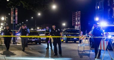 Chicago police investigate the scene where four people were shot, Sunday night, in the 3900 block of West Roosevelt, in the Lawndale neighborhood.