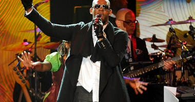 In this Jan. 25, 2014 file photo, recording artist R. Kelly performs at The 56th Annual Grammy Awards Salute to Industry Icons with Clive Davis in Beverly Hills, Calif.
