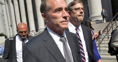 FILE - This Aug. 8, 2018 file photo shows Republican U.S. Rep. Christopher Collins as he leaves federal court in New York. In an about-face, Collins says he will suspend his re-election campaign after insider-trading indictment.