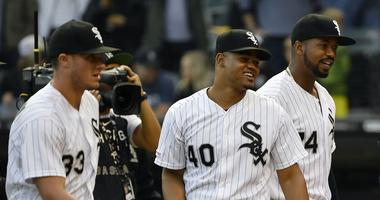 Sep 28, 2019; Chicago, IL, USA; Chicago White Sox starting pitcher Reynaldo Lopez (40), Chicago White Sox designated hitter Eloy Jimenez (74), and teammates celebrate the 7-1 win against the Detroit Tigers at Guaranteed Rate Field.