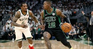 Terry Rozier of the Boston Celtics dribbles against the Milwaukee Bucks' Eric Bledsoe during the 2019 NBA Playoffs.