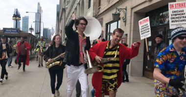 Stanford University's Cardinal Pep Band, in town for the NCAA Women's Basketball Championship Tournament, performs and rallies in support of striking Chicago Symphony Orchestra musicians on the picket line outside Orchestra Hall