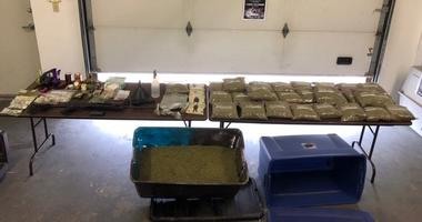 Officers found 940 grams of synthetic marijuana, chemicals used to manufacture the drug, two guns and nearly $3,000 in cash during a search of a home Thursday in Portage, Indiana.