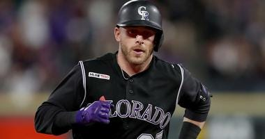 Rockies shortstop Trevor Story rounds the bases after hitting a home run.