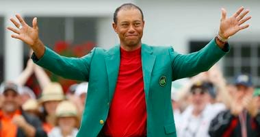 Tiger Woods puts on the green jacket after winning the 2019 Masters.
