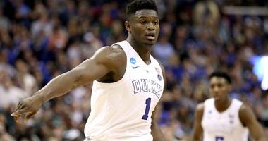 Duke star Zion Williamson points on the court during the 2019 NCAA Tournament.