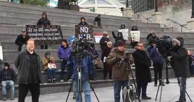 Military veterans hold an anti-war rally downtown Sunday, Nov. 11.