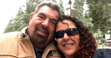 FILE - This Dec. 24, 2018, selfie by Julia Ackley shows herself and her father, Antonio Pastini, at Lake Tahoe near Carson City, Nev. Pastini, who had also gone by Jordan Isaacson and was known for years as Ike, was killed while piloting a small plane.