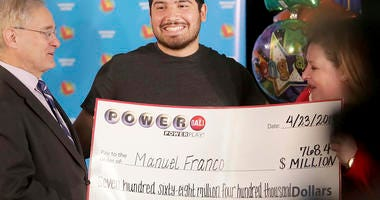 Manuel Franco of West Allis, Wis., winner of second-highest Powerball lottery in history, attends a news conference at the Wisconsin Department of Revenue in Madison, Wis.
