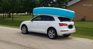 A woman is charged with child endangerment after transporting a pool with children in it atop of her vehicle.