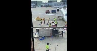 An American Airlines catering truck spiraled out of control Monday on the tarmac at O'Hare International Airport, nearly striking a parked plane if not for an employee who sprung into action to stop it.