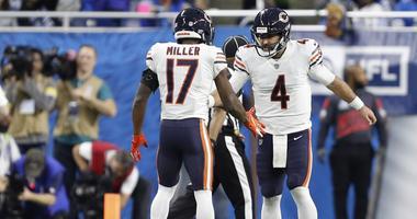 Chicago Bears quarterback Chase Daniel (4) celebrates with defensive back Sherrick McManis (27)