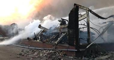 A warehouse collapsed in a fire at Newly Weds Foods in the 4100 block of West Wrightwood on April 2, 2019.