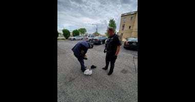 A Niles police officer is winning praise from his department and on social media after literally giving the shoes off his feet to a man in need.