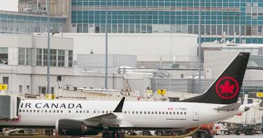 An Air Canada Boeing 737 Max 8 aircraft is parked next to a gate at Trudeau Airport in Montreal, Wednesday, March 13, 2019. Canada's transport minister says the country is closing air space to the Boeing 737 Max 8 jet following a crash