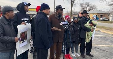 amily members of a black security guard shot to death by a white police officer two weeks ago marched with activists to the Midlothian police station this afternoon.