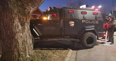Officers from the Posen Police Department conduct search warrant of suspect's home who threatened police on social media