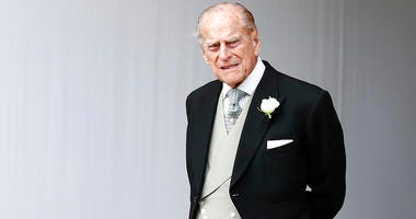 In this Friday, Oct. 12, 2018 file photo, Britain's Prince Philip waits for the bridal procession following the wedding of Princess Eugenie of York and Jack Brooksbank in St George's Chapel, Windsor Castle.