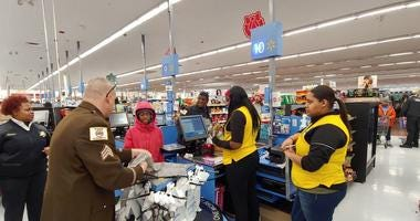 Cook County Sheriff's Deputy buys presents for local kids at a suburban Walmart.