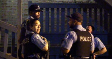 Police investigate a fatal shooting shortly after 9 p.m. Saturday, May 26, 2018 in the 800 block of East 49th St in Chicago.