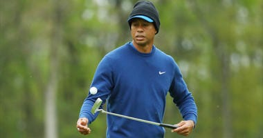 Tiger Woods practices for the 2019 PGA Championship.