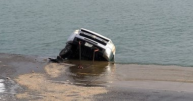 Two city workers escaped a sinking salt truck Wednesday morning after losing control of the vehicle and sliding backward into Lake Michigan.