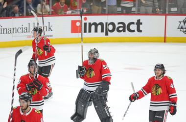 Mar 29, 2018; Chicago, IL, USA; Chicago Blackhawks goalie Scott Foster (90) celebrates following the third period against the Winnipeg Jets at the United Center. Chicago won 6-2
