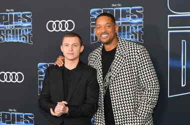 "LOS ANGELES, CALIFORNIA - DECEMBER 04: Tom Holland and Will Smith attends the premiere of 20th Century Fox's ""Spies In Disguise"" at El Capitan Theatre on December 04, 2019 in Los Angeles, California."