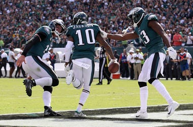 DeSean Jackson #10 of the Philadelphia Eagles celebrates with quarterback Carson Wentz #11 after the pair connected for a third quarter touchdown pass against the Washington Redskins at Lincoln Financial Field on September 08, 2019 in Philadelphia, Pennsy