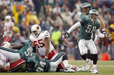 Ike Reese #58 of the Philadelphia Eagles celebrtates his sack of Jake Plummer of and the Arizona Cardinals as the Eagles defeated the Cardinals 38-14 on November 17, 2002 at Veterans Stadium in Philadelphia, Pennsylvania.