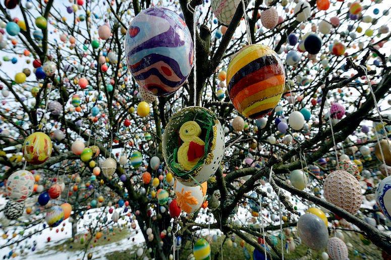 Easter eggs hang in a German apple tree