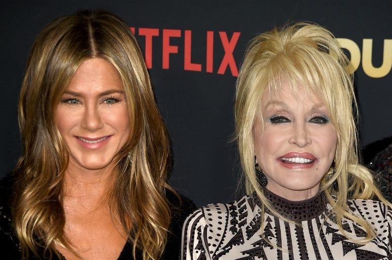 Jennifer Aniston (L) and Dolly Parton arrive at the premiere of Netflix's 'Dumplin'